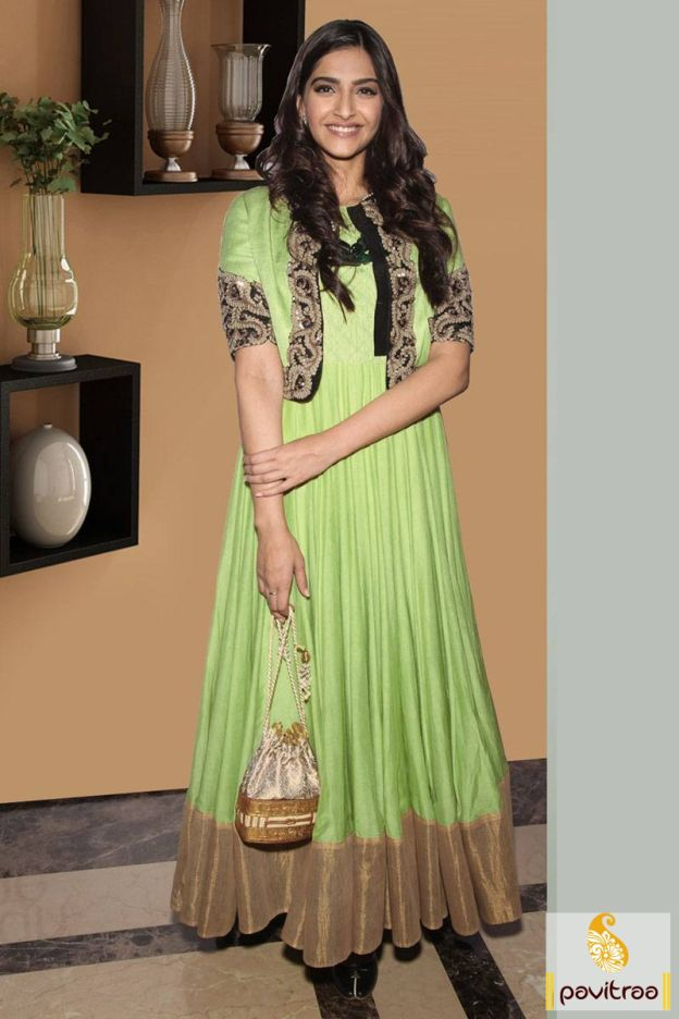 2310/-Rs, Look magnetizing with stylish actress Sonam Kapoor lime anarkali salwar kameez. A trendy suit is stylish with its koti design with embroidery work.