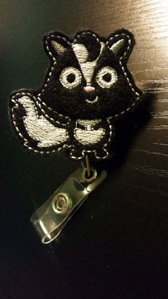 Cute black and white skunk Badge Retractable by BadgeToTheBone