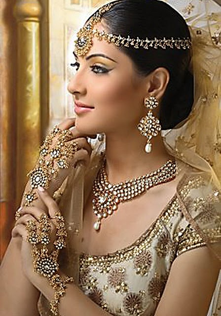 Indian bridal ensemble in gold and nude
