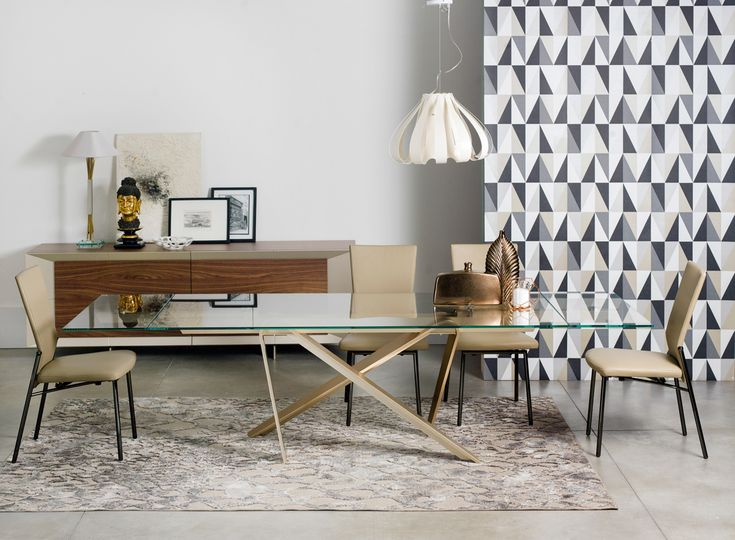 Contemporary glass and brass dining table by NAOS, a European furniture designer