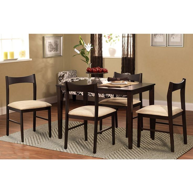 Super sturdy and beautifully crafted, the Transitional 5-piece Dining Set uses simple lines to draw your attention. From the open back chair with curving top rail to the straight forward table design, this set will update any decor.