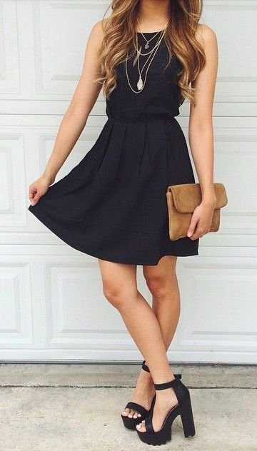 black dress. platform sandals.