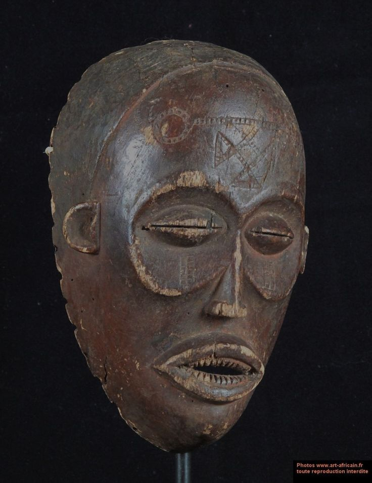 Beautiful and elegant female face mask called Pwo. The appearance of this mask Pwo perfectly illustrates the major characteristics of the Chokwe style in Angola, including its eyes half-closed in the center of large concave orbits and the presence of scars. The teeth are cut into wedges, it was once a symbol of beauty. Pwo is dressed like a woman for dance. The man who wears the mask moves with grace. With her dancing Pwo teaches women good manners.