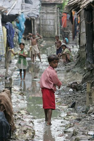 A slum in India. Thousands of children are orphaned and left homeless on the streets. These children have to fend for themselves and relinquish their rights to a pleasant childhood.