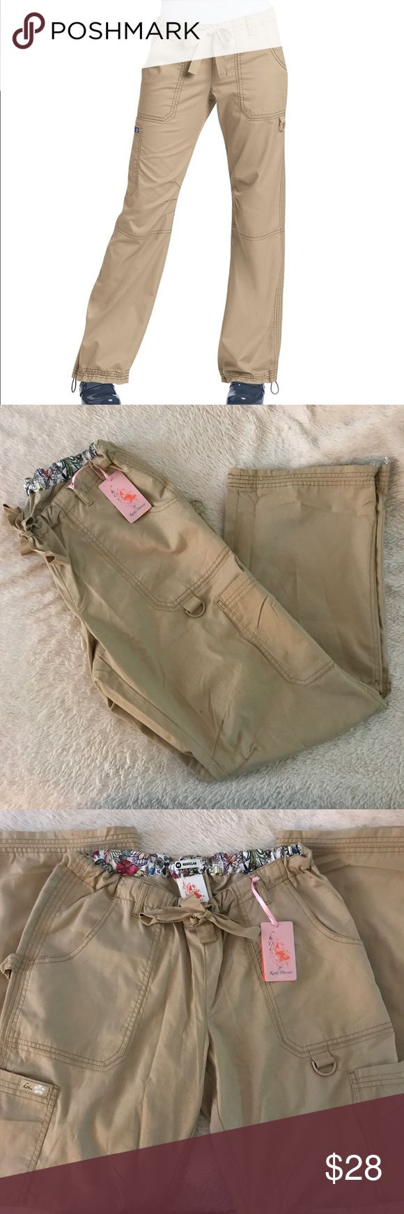 BNWT KOI Lindsey scrub pants size M I purchased these for my daughter and they are too big :( I can't return them since I got them from a vendor at the hospital, so figured I would sell them here. I paid $31.95. Selling for less, but no low ballers please! These are regular length with an inseam of 31 KOI Pants