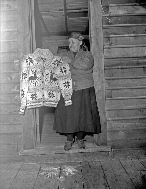 Cowichan Knitter with sweater sometime between 1941 and 1943.