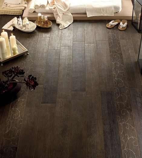 Ceramic tile that looks like wood.....perfect for a kitchen, bathroom, or basement. The beauty of wood with the ease of ceramic- and no grout lines.