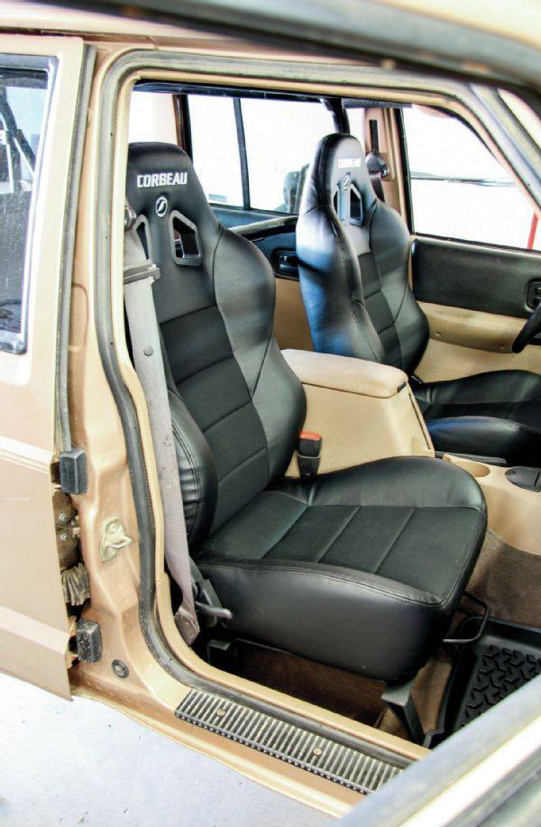 Corbeau's Baja XRS seats recline, which was a big draw for us. While we knew the seats were a touch larger than the stock seats, we were a little surprised at how snug of a fit they were inside the Jeep. If we didn't have the Rock Hard 4x4 'cage, we could have gotten a bit more movement. In the end, we were able to get both seats situated in a comfy position.