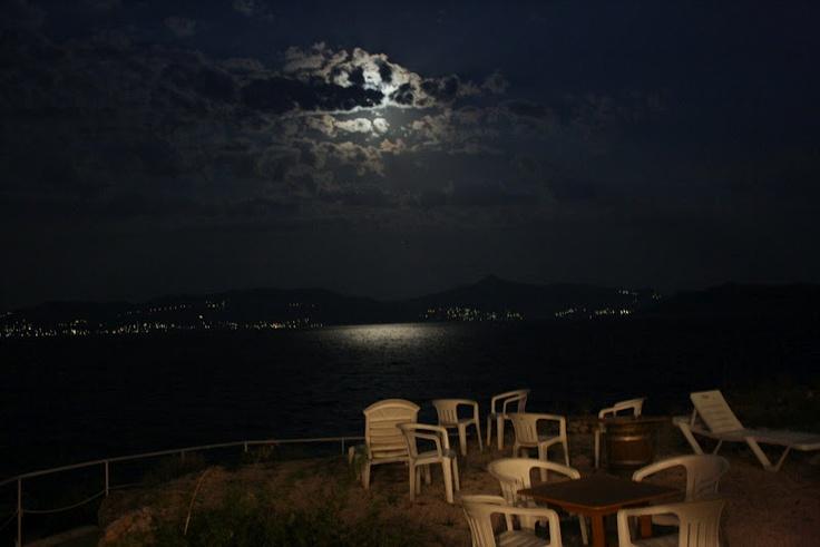 Beautiful moon shot from Agistri Island, Greece. Island of Aegina in the distance.