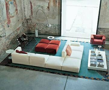 Love the reversed sections of the modular sofa to allow for two seating areas.
