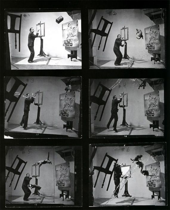 This photo was shot live, no amount of post-processing or Photoshop has been used to achieve this effect. It took 26 attempts and 5 hours. Philip Halsman would count to four, where Dali would leap into air, and three assistant will throw the cats, another will throw a bucket of water, and Mrs. Halsman held the chair.