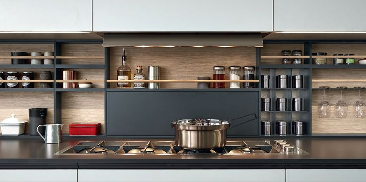 Varenna_Phoenix_modular equipments Shaker in grafite embossed lacquered aluminium, back panels in oak melamine. Built-in Easy hood integrated in the central wall unit. Shaker is a very functional element that grants a rational organisation of the rear part of the worktop.