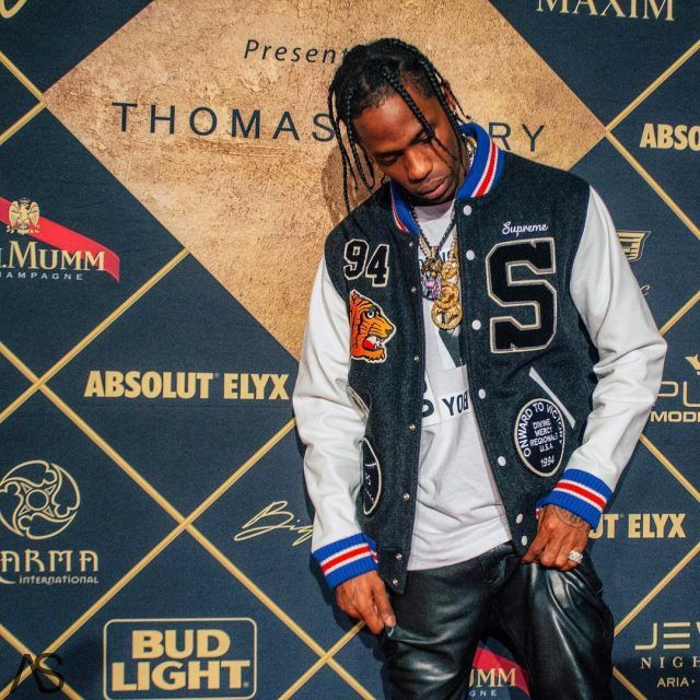 Travis Scott Performs Wearing Supreme Jacket, Helmut Lang x Travis Scott T-Shirt, Saint Laurent Jeans, and Air Jordan Sneakers For Super Bowl 51 | UpscaleHype