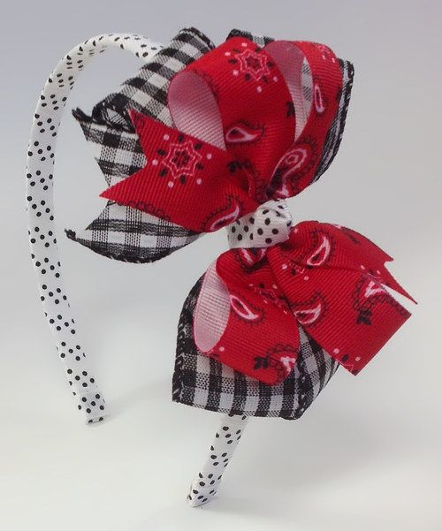 A little lady can never have too many bows. Add one more with this playfully layered piece. Classic gingham blends effortlessly with a punchy bandanna print to create a piece sure to stand out in any accessory collection.