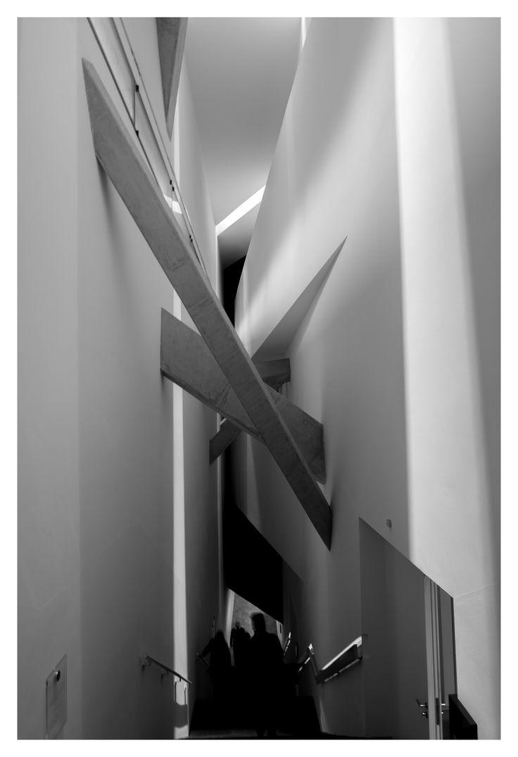 Jewish Museum, Berlin   Daniel Libeskind #jewishmuseum #jewishmuseumberlin #berlin #germany #architecture #interior #design #columns #stairs #bracing #abstract #blackandwhite #greyscale #monochrome