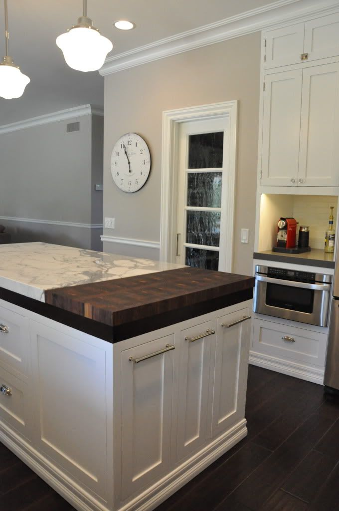 Island - like the split marble/granite + butcher block surface, and the pull out drawers for trash + recycle + compost!
