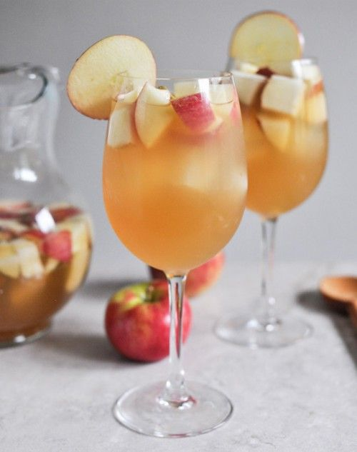 This sangria recipe calls for a blend of pinot grigio, fresh apple cider, ginger brandy and fresh honey crisp apples and pears. The apples and pears are cleaned and chopped. If peeling them is preferred then that's cool too. Once measured, all of the ingredients are mixed together and stirred. They are refrigerated for an hour or so and then served.