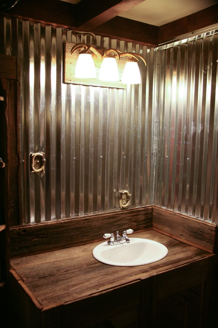 Bathroom we used barn tin and barn wood to keep Bath barn