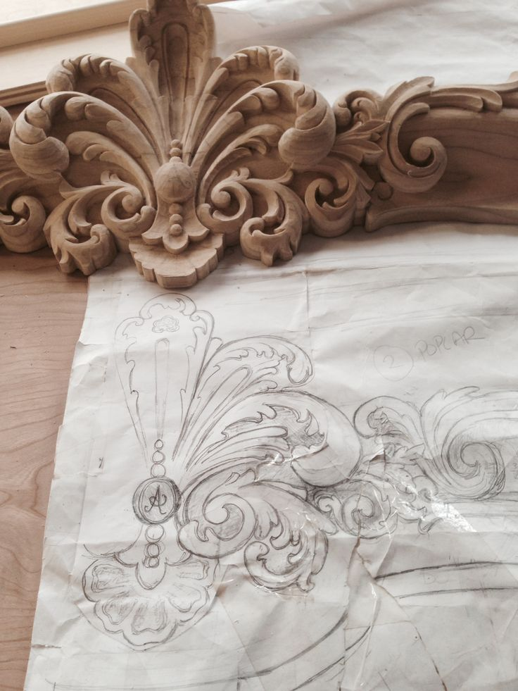 Detail of Hand carved fleur for curved bonnet on built in china cabinets for a Boiserie dining room. Drawing hand carving shown here in raw domestic hard wood. Manufactured designed by Auffrance.