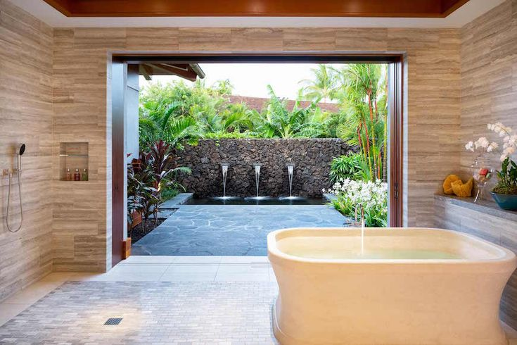 This luxury bathroom has a lot of space around it and it connects to an outdoor garden which will definitely make you feel even more refreshed while bathing. ➤To see more Luxury Bathroom ideas visit us at www.luxurybathrooms.eu #luxurybathrooms #homedecorideas #bathroomideas @BathroomsLuxury