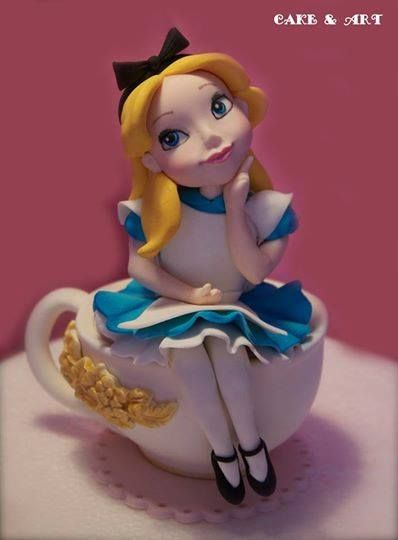 Alice in wonderland cake topper.