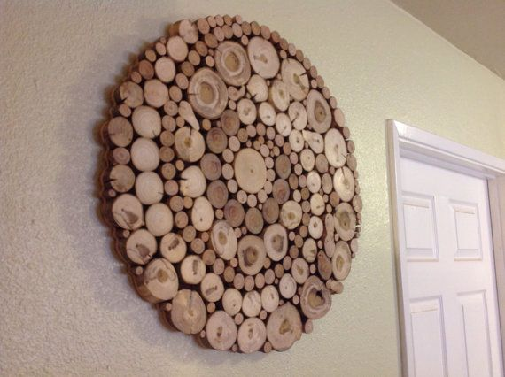 Gorgeous wood slice art of a perfectly imperfect large circle with uniquely patterned spirals. Circle size is 24.5 inches across - Routed edges for floating appearance, dark brown solid stained background for contrast Our one of a kind wood slice art pieces are made from locally repurposed (mostly fallen) trees including Mulberry, Pepper, Oak, Walnut, Eucalyptus and similar species from San Diego County. We also custom make to order specific pieces with most any range of dimensions, ...