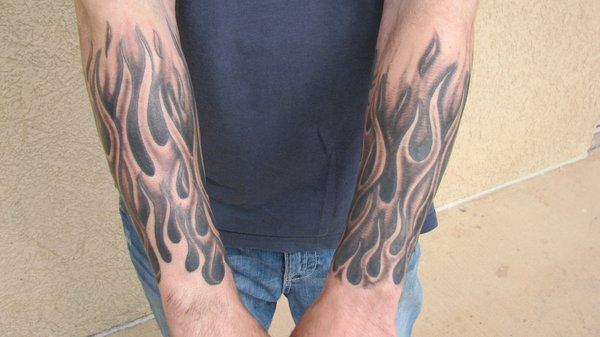 Black and grey flame half-sleeve tattoo by Steve Anderson