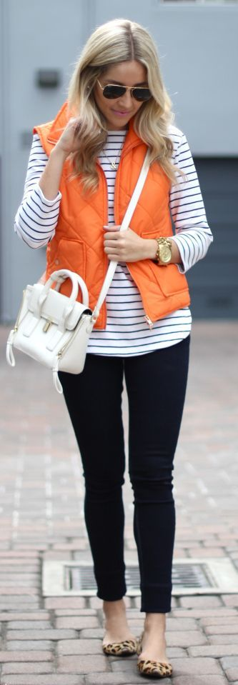 Striped shirt, orange vest, black skinny jeans, and leopard flats