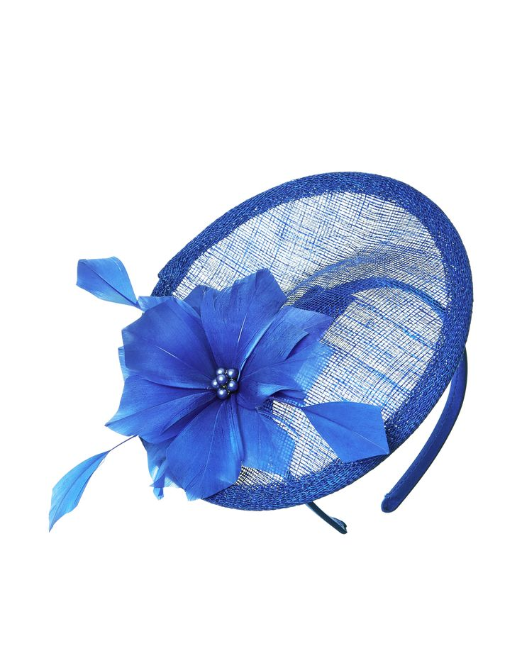 Add the finishing touch to your occasion look with our Charlotte fascinator, crafted with a crin disc with a feather flower, set on a slim band.