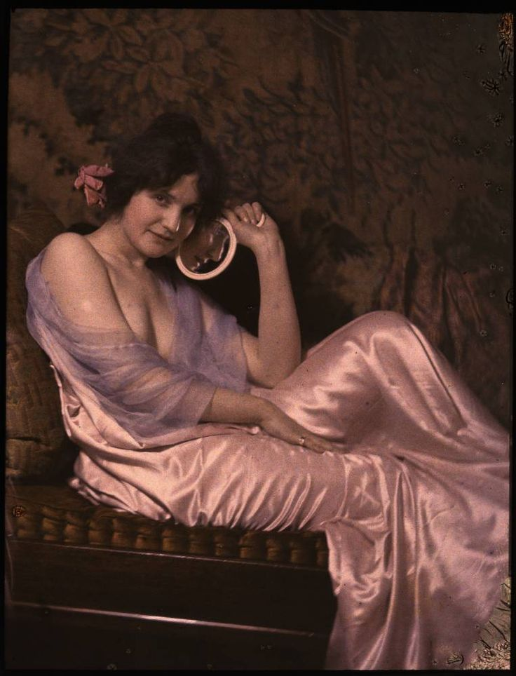 Woman in satin dress holding a mirror  George Eastman House Autochromes