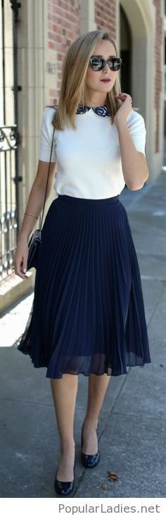 White top, navy skirt and some nice details