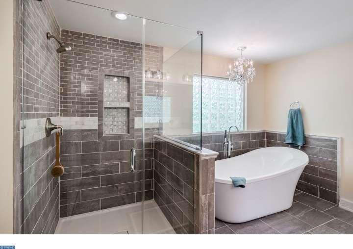 Contemporary master bathroom with chandelier salerno for Master bathroom grey tile