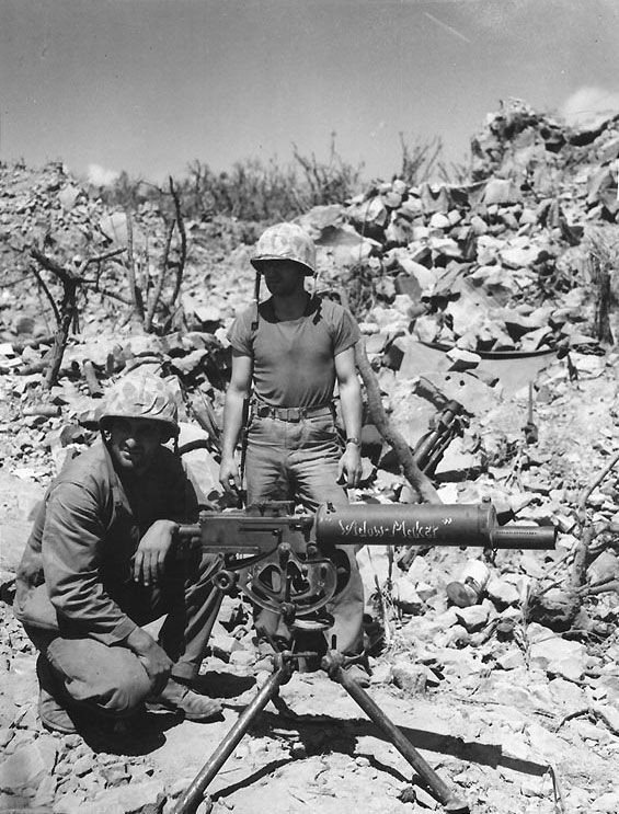 """A .30 caliber Browning water-cooled machine gun and its crew on Iwo Jima, circa Feb-Mar 1945. *Note the name """"Widow Maker"""" on the barrel."""