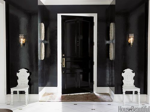 In a Houston house with Georgian bones and siren allure, the drama begins in a foyer swathed in Phillip Jeffries's Lacquered Walls in Eyeliner — a long-lasting vinyl that mimics lacquer.