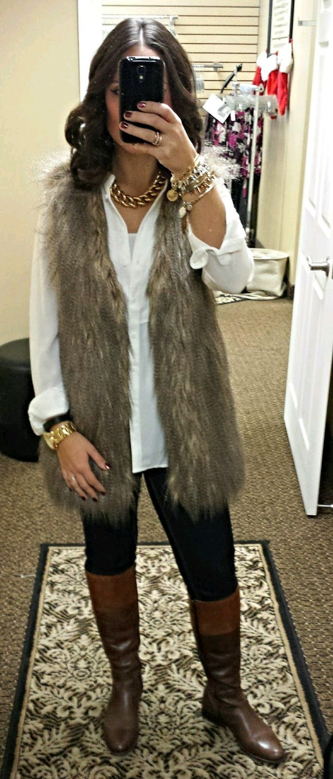 Fur vest, white blouse, dark jeans and your favorite pair of boots! Then accessorize this beautiful outfit with either silver or gold costume jewelry!!