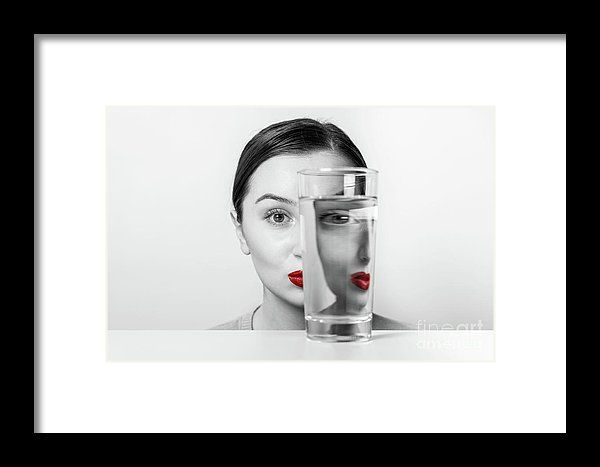 Woman Face Distortion In Glass Of Water Framed Print
