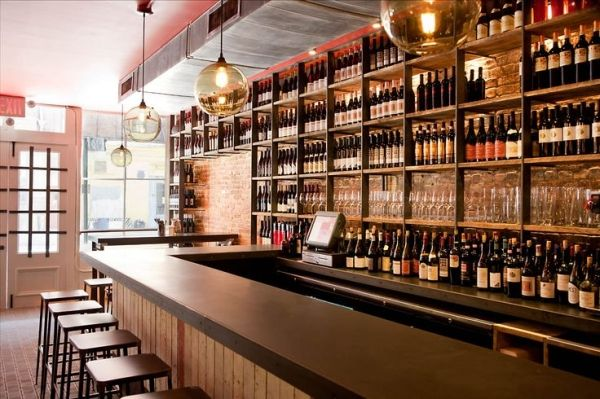 Terroir Wine Bar, NYC. The concrete and wine bottles are soooo cool. by danielle