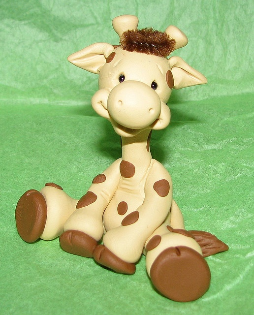 would make a cute cake topper out of fondant (polymer clay giraffe)