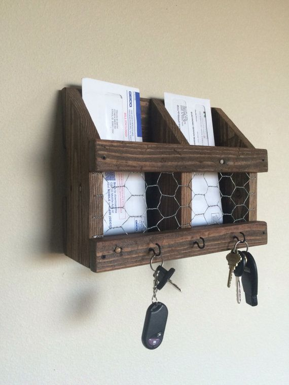 Mail and key rack. Organize your mail and hang your keys. Primitive and rustic for a country feel. Stain is provincial. Chicken wire front. 3 key hooks. Finished screwed together. Very rigid. Installation: Simply screw to the wall. Approx dimensions. 12 wide. 95/8 tall. Inside slot widths 43/4. Note: Naturally, reclaimed wood has imperfections, including its texture, weathered appearance, nail holes, and knots. We are selective with the pieces we choose to work with, ensuring ...