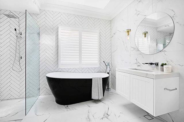 We couldn't have chosen this statement black bath if we didn't have the luxury of so much natural light in this bathroom ☀️ #skylight | Bath @caromaaustralia Noir 1700 | @ambertiles | vanity @carrerabydesign | bench 'statuario maximus' @caesarstoneau | tapware @dorfaustralia | polysatin shutters @luxaflexaus | towel @adairs