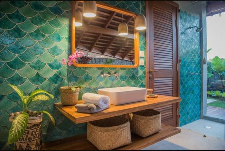 Tropical bathroom with blue fish scale time detail.... yes!!!