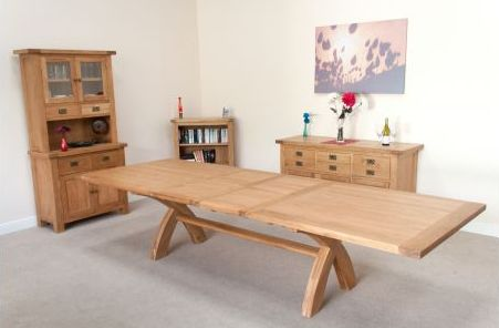found here: http://www.topfurniture.co.uk/p/dining-tables/2.4m-2.9m-3.4m-country-oak-cross-leg-double-butterfly-extending-dining-table.html