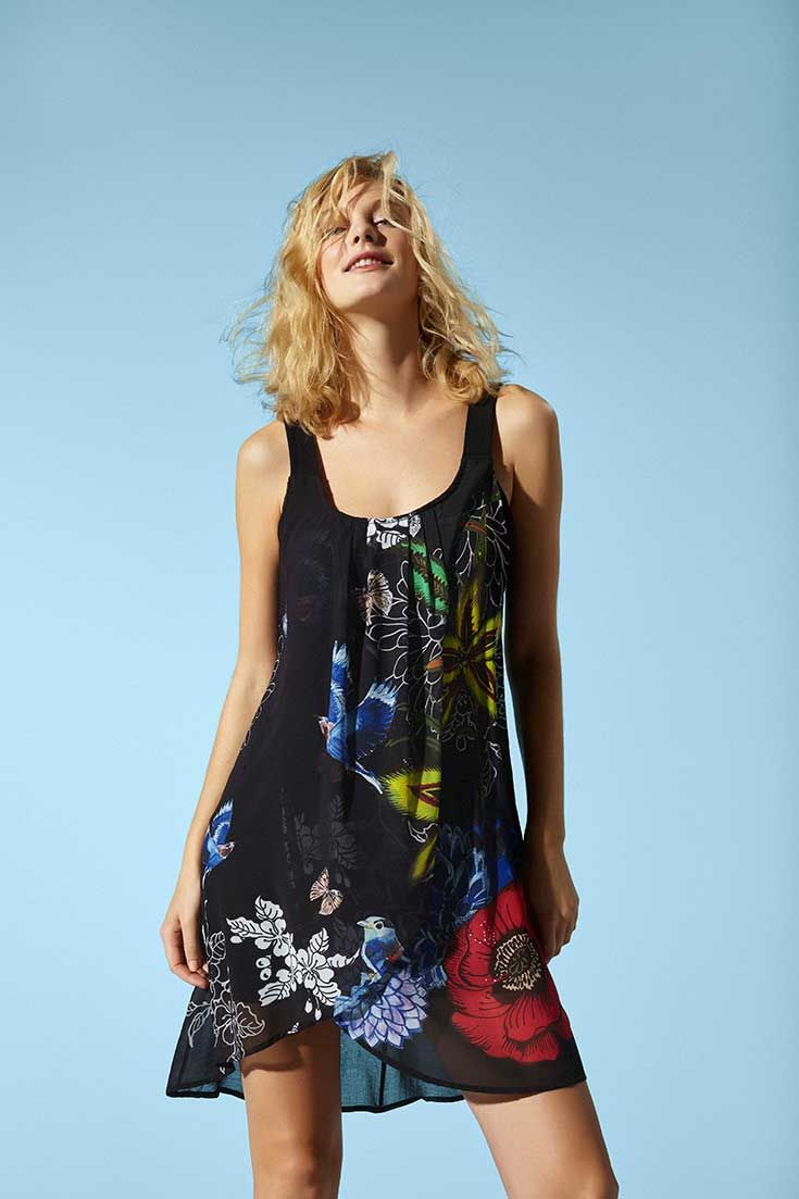 Sleeveless black dress with a crossover layer of printed chiffon.