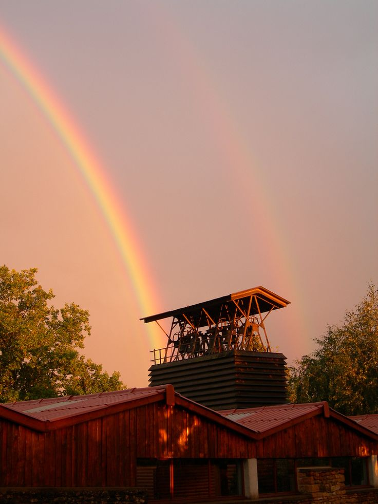 | Double rainbow over Taizé | A double rainbow starts besides Taizé bells