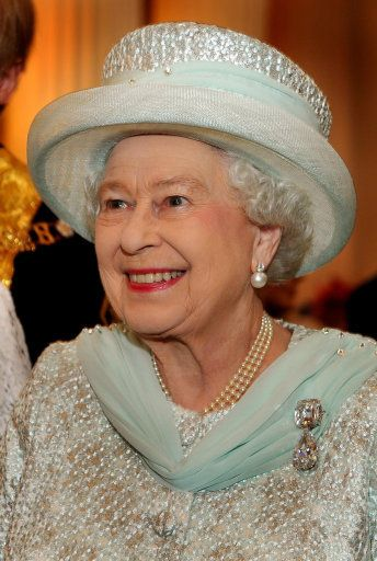 In celebration of Queen Elizabeth's Diamond Jubilee, the queen looks put together as ever with a pearl necklace, pearl earrings and a stunning diamond brooch.     The Queen meets guests in the Egyptian room of Mansion House during a reception hosted by the Lord Mayor of London and the City in honour of her Diamond Jubilee, London, 5 June 2012.