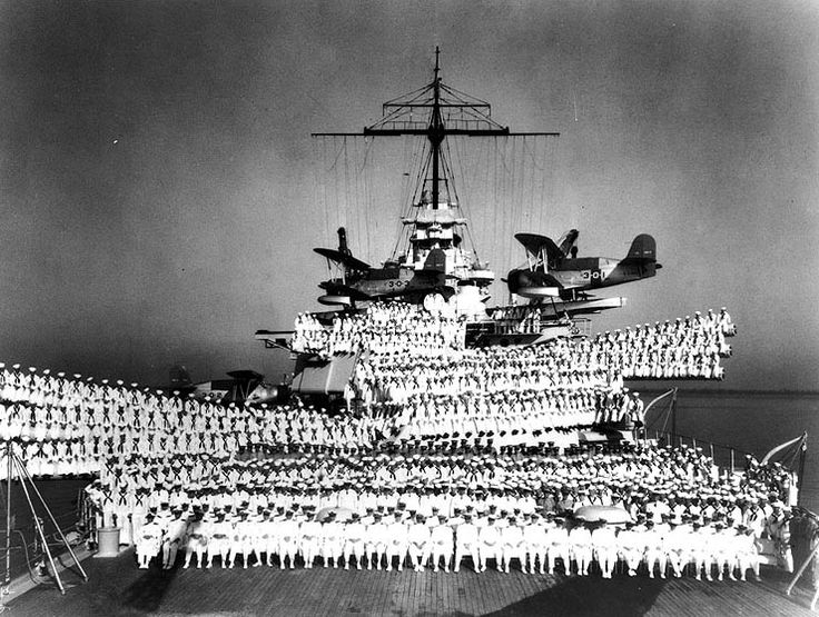 Officers and crew of battleship Idaho posed on the after deck and after 14-in gun turrets, circa 1938; note SOC-3 Seagull floatplanes of Observation Squadron Three atop Turret #3 catapult and on deck