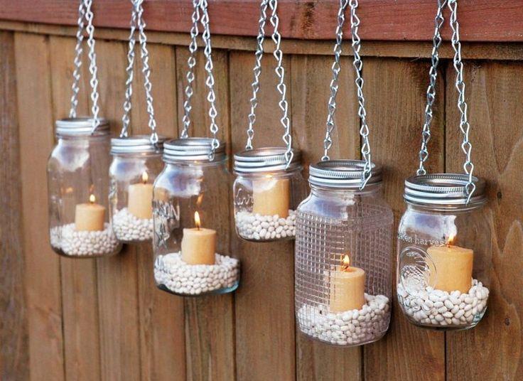 Einweckgläser als Kerzenhalter gefüllt mit weißen Bohnen