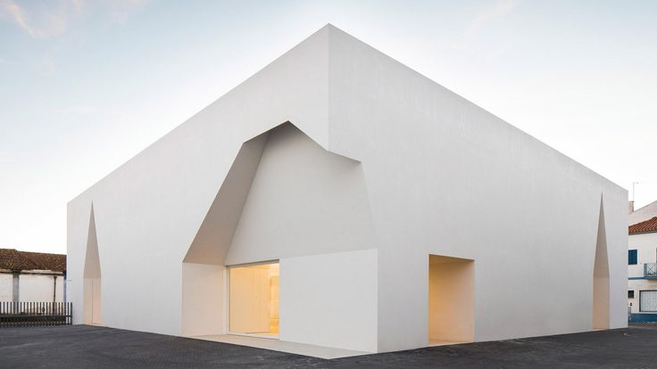 Irregular cutouts mark entrances to Aires Mateus' community centre in Portugal