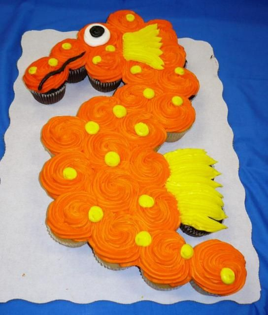 Cupcake Cake: similar layout for dragon but add (icing) breath of flames, fondant/icing triangles for scales,...
