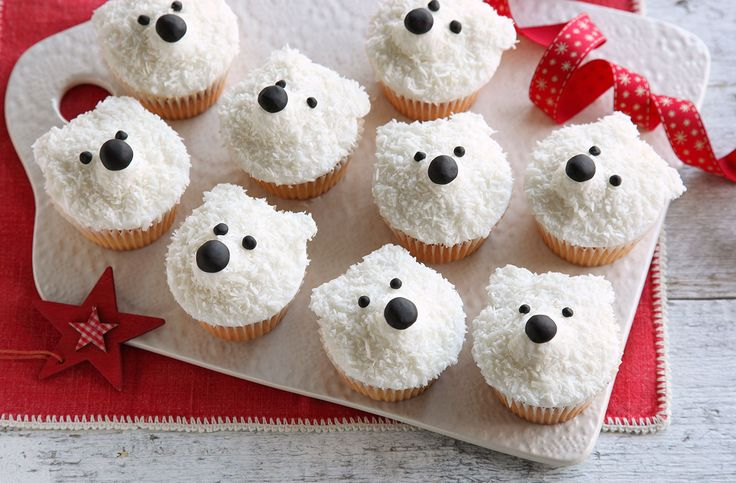 Made with sweet fondant icing and delicious desiccated coconut, these cute polar bear cupcakes make the perfect Christmas treats to share with friends and family. | Tesco